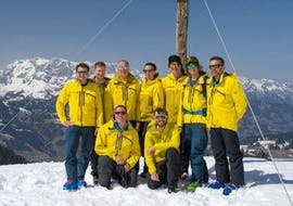 A group of instructors of Wolgang Pfeifhofer stand on top of a mountain during a private ski touring guide for all levels.