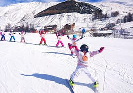 Kids are happy to take their first slides on the snow during their Kids Ski Lessons (3-12 y.) for First Timers - February with the ski school ESF La Foux d'Allos.