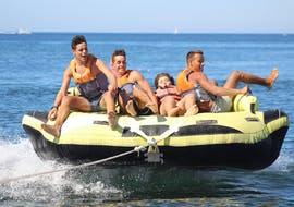 Four guys having fun in one of our inflatables during the Crazy Sofa, Crazy Cookie and Aqua Twister at Armação de Pêra with Moments Watersports.