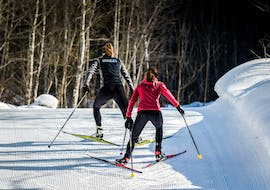 A ski instructor from Schweizer Skischule Grindelwald and her female student are skating uphill during the Cross-Country Skating Lessons for All Levels.