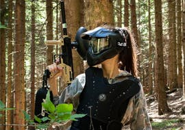 A young woman is planning her next move during a game of Paintball in Upper Savinja Valley organized by Funpark Menina.