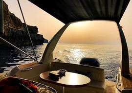 Vitamin Sea boat stops to admire the breathtaking view of the coast of Gozo during the Boat Tour around Gozo at Sunset.