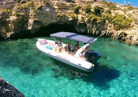 The rib stops at a quiet cove for a swim in the crystal clear water during the Boat Tour around Gozo's Caves with Vitamin Sea.