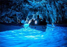 A group of participants at the entrance of the Blue Grotto during the boat trip from Sorrento to Capri with Lubrense Boats Amalfi Coast.