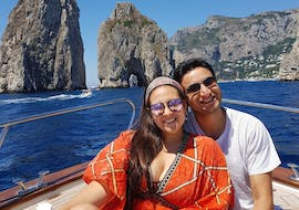 A happy and smiling couple during their Private Boat Trip from Positano to Capri with Lubrense Boat Costiera Amalfitana.