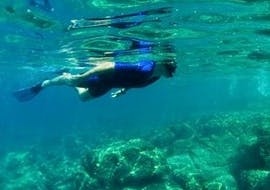 A girl can be seen Snorkeling in Nice with Chango Diving dive centre.