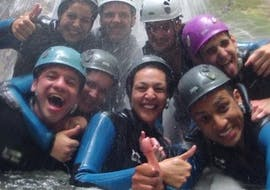 A group of people is laughing  in the canyon Pont du Diable during the Adventurous Canyoning with Takamaka Aix-les-Bains