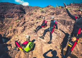 A group of people practice canyoning in the Barranco de Los Cernícalos with Climbo.