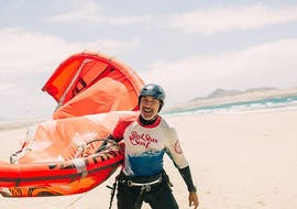 A man is smiling into the camera during his private kitesurfing lessons on famara beach with red star surf lanzarote.