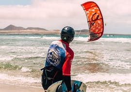 A man enjoys its time during his kitesurfing lessons on famara beach with red star surf lanzarote.