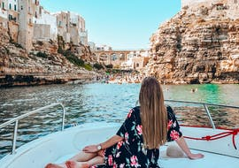 A girl during the private boat trip to the Polignano a Mare caves with Pugliamare.