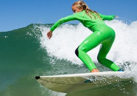 Girl during her surfing lessons in La Salie Beach with Ocean Roots.