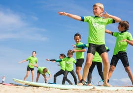 Children during their surfing lessons on Salie Beach with Ocean Roots.