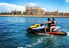 Two people go on a jet ski safari around Palma de Mallorca with Mallorca on Jetski.