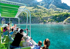 People enjoy a boat trip to Llevant Natural Park with Alcúdia Sea Trips.
