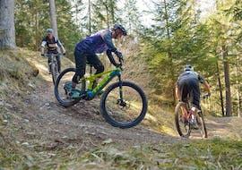 Three friends riding downhill during their E-Mountain Bike Hire in Lenzerheide with Epic Lenzerheide.