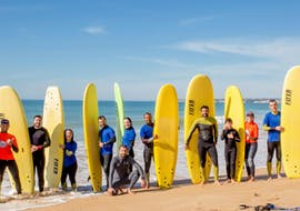A group of people is pictured on the beach during their Multi-Day Surf Course for Kids & Adults - All Levels with Surf Albufeira.
