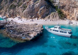 During a Boat trip in the Gulf of Orosei & Bue Marino Caves Low Season with Motonave Pegaso Cala Gonone a picture is taken with a drone.