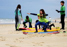 Kids doing surfing lessons for kids on Lacanau Beach with HCL Lacanau.