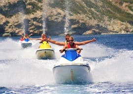 A group of people enjoy a jet ski safari in Heraklion Bay with snorkeling with h2o Water Sports Heraklion.