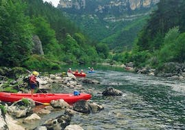 Friends are enjoying the natural wonders of the Tarn Gorges during their Canoe Rental on the Tarn River - Adventure 18km with Canoë Aigue Vive Gorges du Tarn.