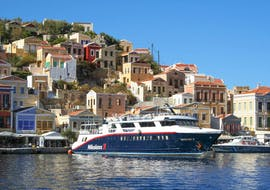 The Manos Going Rhodes boat mooring at Symi Town during the Symi Island Cruise to Symi Town & Panormitis Monastery.