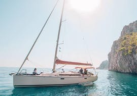 A sailing boat can be seen sailing from Hvar to the Pakleni Islands on a full-day boat trip by The Day Sail Croatia.