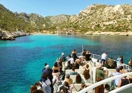 People on a Small Boat Trip in the heart of the Calanques with Croisiere Marseille Calanques.