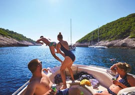 A group of friends have fun during a boat trip from Split to Solta, Drvenik Veli and the Blue Lagoon with One Day Escape.