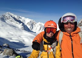 Two skiers smiling during their private ski lessons for kids of all levels in Lech with ski school Warth Vorarlberg Snowsports.