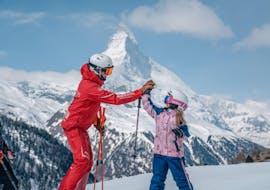 A kid is doing Kids Ski Lessons (6-14 y.) for Beginners with Swiss Ski School Zermatt - Zermatters.