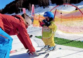 A little skiers learns how to ski in the Kinderland with Top Secret ski school in Davos Klosters.