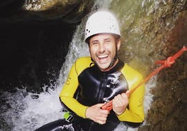 During the Canyoning for Adventurers in the Starzlachklamm organized by canyoning erleben, a happy participant is roping down over a waterfall.