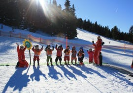 A group of children and their ski instructors from the ski school Skischule Lechner are enjoying themselves in the Kinderland area during the Kids Ski Lessons and Day Nursery - (3-5 years).