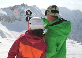 A ski instructor from the ski school Alpin Skischule Oberstdorf is showing his student during the Private Ski Lessons for Adults - All Levels the area of Oberstdorf.