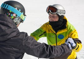 female snowboard instructor with student