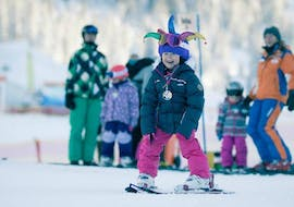 A girl is really happy after her private ski lessons for kids of all ages with ski school Total Ehrwald at Zugspitze.
