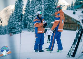 2 private ski instructors are waiting for some skiers that will take some private ski lessons with ski school Total Ehrwald at Zugspitze.