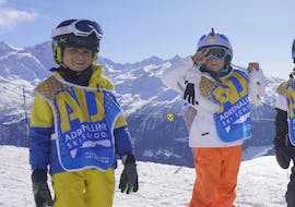 Two children learn to ski during a kids ski lessons 6 Max with Adrenaline Verbier.