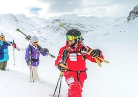 An instructor from the ski school ESF Ski School Val d'Isère is heading with a group of ski enthusiasts to the best freeride hotspotst during the Off Piste Skiing Lessons - All Ages.