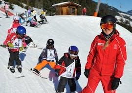 Kids Ski Lessons (3-14 y.) for Advanced Skiers with Ski School Jochberg