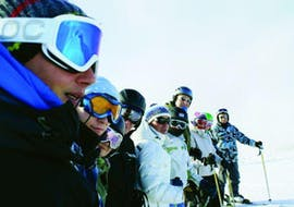Adults attending adult ski lessons for beginners at the Ski School Zell am See Outdo .