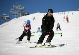 A child takes private ski lessons for kids of all levels at the Ski School Zell am See Outdo .