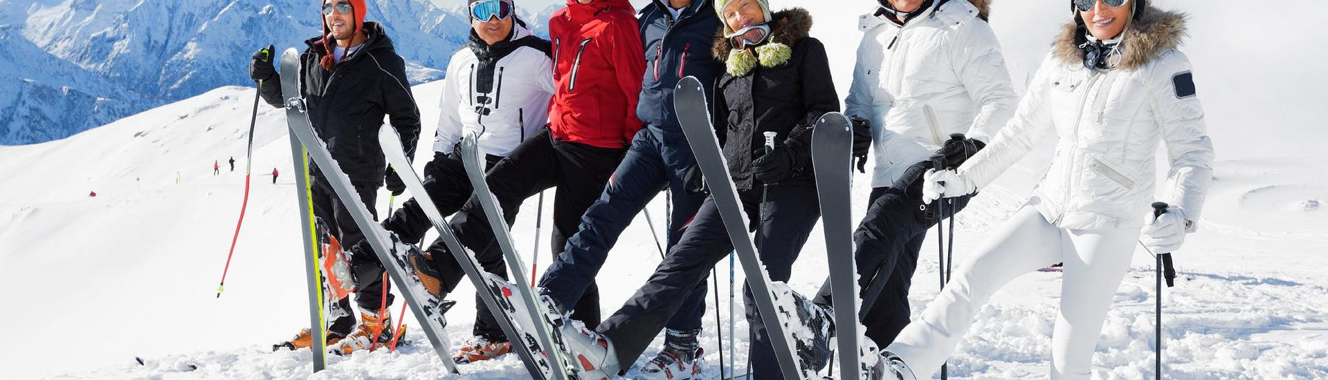 A group op adult skiers during their adult ski lessons for all level with ski school Dachstein West in Gosau.