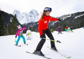 A group of children practising during their private ski lessons for kids of all levels with ski school Dachstein West in Gosau.