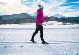 A skier during a private cross country skiing lesson for all levels with ski school Dachstein West in Gosau.