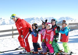 A group of small children during their kids ski lessons (4-14 y.) for beginners with skischule Heugenhauser Saalbach.