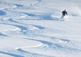 A skier on the slopes during the private ski lessons for adults with ski coach Rupert Rinder.
