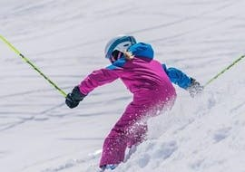 A girl is enjoying skiing during the Private Ski Lessons for Kids - All Ages under the supervision of an experienced ski instructor from WIWA   DSV Skischule & Skiverleih.