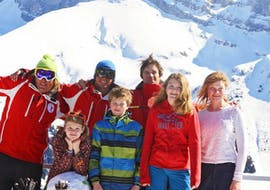 A Family is taking a break during the Private Ski Lessons Special Family with Redcarpet swiss snowsports in Leukerbad.